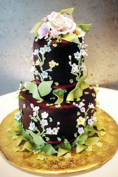 All edible tiered cake in chocolate ganache, with white chocolate and fondant decoration