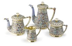 A Russian Gilded Silver and Enamel Four-Piece Tea and Coffee Set, Gustav Klingert, Moscow, 1891, comprising a coffee pot, teapot, covered sugar bowl and creamer, each colorfully enameled with birds inhabiting flowering foliage against a stippled gilt ground.
