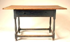 18th c. New England pine tavern table, early black painted finish, breadboard top, single dovetailed drawer (replaced), turned legs, boxed stretcher base, good feet.