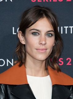 Trust Alexa Chung to keep it both simple and fresh with a middle part, pulled-back hair,and natural-looking waves.