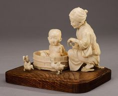 Japanese Carved Ivory Group Grandmother with Child - by Myers Auction Gallery
