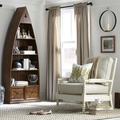 This nautical-inspired bookshelf features a unique, boat-shaped silhouette. Constructed of solid pine, four shelves and two drawers allow for ample displa...