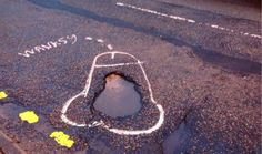 'Wanksy' is spray-painting penises around potholes so that his local council has to come and fill them in.