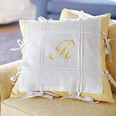 Linen Napkin Pillow Slipcover  Put plain linen napkins to good use as a pillow slipcover. Embellish two napkins with rows of pin tucks. Machine-embroider a monogram in the center of one. Sew eight ties to each napkin, sandwich a pillow between the two, and tie the slipcover together.  Easy to wash the slipcover....