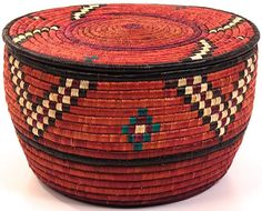 Africa | Coiled stitched baskets woven by the Nubian women in Darfur, Sudan | Papyrus stalks inside the coils and palm leaf on the outside;  the palm leaves give a sheen to the surface of the baskets.