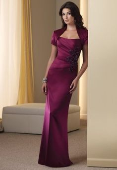 MON CHERI 111907  This Mon Cheri 111907 style dress is great for events necessitating a evening dress..COLOR: Plum - SIZE: 14 -- FAST SHIP