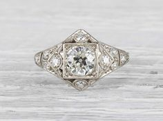 Antique Edwardian engagement ring made in platinum and centered with an EGL certified 1.05 carat old European cut diamond with G-H color and SI2 clarity. Circa 1925