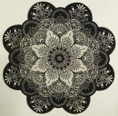 Black and white mandala tattoo.