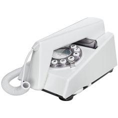 TrimPhone Wit, Retro Telefoon. TRIM staat voor Tone Ringer Illuminated Model: het was de eerste telefoon die belde met behulp van een modern elektronisch geluid in plaats van het traditionele klok mechanisme. Deze replica versie heeft de stijl en de kenmerken van het jaren 70 origineel, maar met moderne drukknop kiezen.
