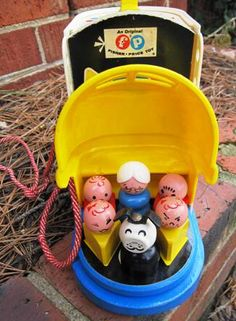 Wooden little people and wooden shoe with some plastic..miss those wooden toys!