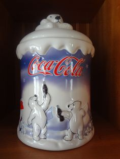 Coca Cola does not even have to sell something to do with a caffeinated beverage. Here they sell a cookie jar, with the classic Coca Cola polar bear on it.