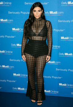 For MailOnline's yacht party in Cannes, France, Mrs. West donned a sheer lace LaQuan Smith maxidress over black undergarments. She topped off her look with black heeled sandals.