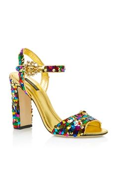 Dolce & Gabbana's sandals are covered with scores of glistening sequins that are rendered in a kaleidoscope of hues. Set on a chic block heel, it's complete with a crystal-embellished ankle strap. Wear yours with skirts and dresses.