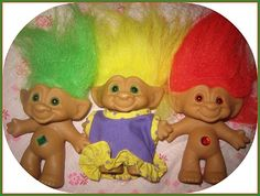 Troll dolls, originally known as Leprechauns and also known as Dam dolls, Gonks, Wishniks, Treasure Trolls, and Norfins, became one of the United States' biggest toy fads from the autumn of 1963 through 1965  They all have signature tall (colorful) hair, a lovable face and a pot belly. Trolls became fads again in brief periods throughout the 1970s, 1980s and 1990s, with as many as ten different manufacturers creating them.