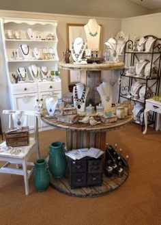 Love the round wood double stack tables! boutique displays i Boutique Decor, Boutique Store Displays, Boutique Jewelry Display, Boutique Ideas, Jewelry Store Displays, Display Ideas For Jewelry, Consignment Store Displays, Jewelry Shop, Jewelry Table Display