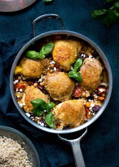 Skillet chicken with chickpeas, tomatoes, and olive recipe. This quick and easy recipes is perfect for meals and dinners during a fast and busy weeknight! Cook it in your favorite cast iron skillet!