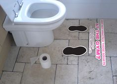 So funny, we should do this on campus. I like how they added shoe marks by the toilet.