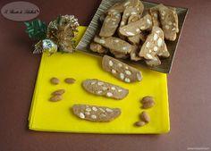 Ricetta dei pepatelli: dei biscotti con le mandorle tipici del teramano che si preparano durante il periodo natalizio.