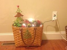 Foyer decoration with Family Dollar ornaments in an old longaberger basket.