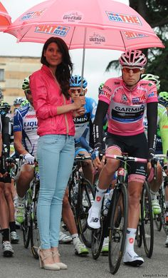 Ryder Hesjedal in Pink/BIKE!    I love her outfit! Totally me.  Pink and Bikes