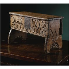 THE 'ALCHEMISTS' CHEST A rare and small medieval carved oak boarded chest 15th/16th century SOLD. 5,250 GBP