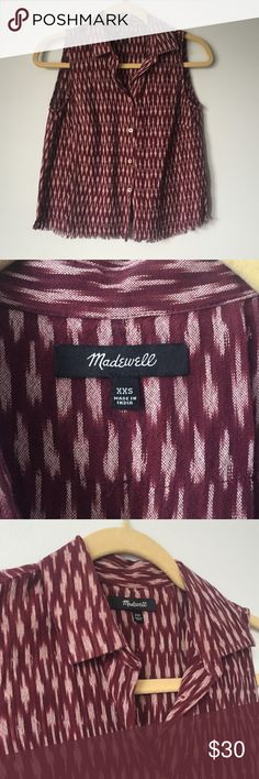 Madewell Ikat Sleeveless Blouse Madewell maroon blouse with ikat pattern, perfect condition. Great for summer concerts with high waisted denim shorts or brunch with white jeans. Unfinished hem is a cute detail, slightly boxy/cropped fit. I'll take reasonable offers! Madewell Tops Tank Tops