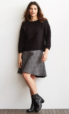 A simple black pull over sweater will look great with any skirt or pant.  Keep it trendy with a pair of booties.
