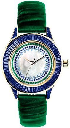 DIOR Ladies Pièce Unique watch N°13 is made in harmony range of shades of blue sapphires and green emeralds, accented by a pearl dial