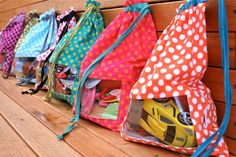 toy bags with a window  Link to tutorial:  http://tonicoward.blogspot.com/2010/06/peek-boo-toy-sack-tutorial.html