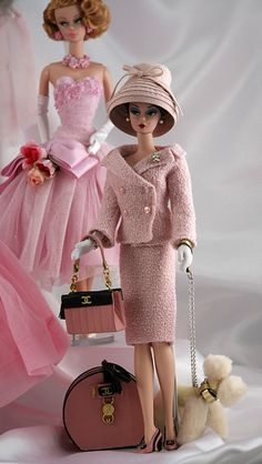 Barbie in her pink travelling suit... how chic!  (my barbies never looked like this, love the poodle)