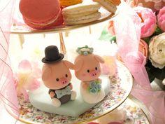 Handmade lovely piggy and piglet bride and groom wedding cake topper. $130.00, via Etsy.