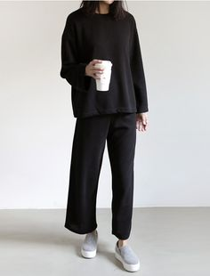Black sweater, cropped wide-leg trousers & grey slip-ons | @styleminimalism
