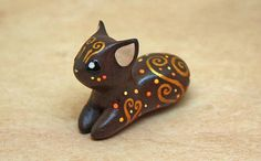 A #cute autumn #cat looking for home. 1.1 inch in height, 1.6 inch in length. Velvet clay, acrylic paint. Made by Ailinn Lein, a member of our studio. You can find other w... #sculpture #nature #brown