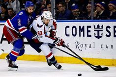 Battle along the boards:   Capitals center Jay Beagle ﴾83﴿ battles for the puck with the Rangers center Kevin Hayes ﴾13﴿ during the third period at Madison Square Garden in New York on Feb. 19. The Rangers won 2‐1.