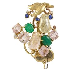 Seaman Schepps Multicolored Gemstone Gold Brooch | From a unique collection of vintage brooches at https://www.1stdibs.com/jewelry/brooches/brooches/