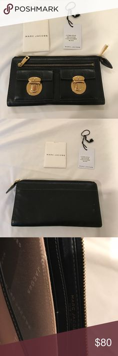 Authentic Marc Jacobs calf leather zip clutch Authentic Marc Jacobs calf leather zip clutch / wallet - black - with original tags Marc Jacobs Bags Clutches & Wristlets