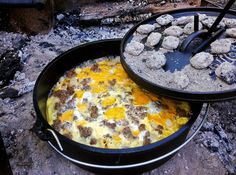 Mountain Man Breakfast Casserole (adapted from a recipe by Lodge Cookware) 1 package sausage 1 large onion, chopped 2 packages Simply Potatoes (hash browns or diced) 1 cup diced cheddar cheese 1 dozen eggs, scrambled salt and pepper to taste  Brown the sausage in a cast iron Dutch Oven over a hot coal fire.  Remove and drain the sausage on paper towels.  Saute the onion in the remaining drippings until tender.  Add the potatoes and stir until crispy and lightly browned.  Spread the potatoes…