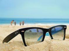 sunglasses in the sand...family in the background