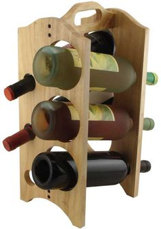 This wine rack has a very simple design. By being made out of wood, it enhances the 'minimalism' in the product. As well as being about to hold up to 6 wine bottles, it houses the bottles at a slight angle, making the design unique. Bottle Rack, Wine Bottle Holders, Wine Bottles, Wine Decanter, Wine Caddy, Wine Rack Storage, Rustic Wine Racks, Wine Craft, Wine And Beer
