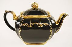 Beautiful black tea pot with gold accents.
