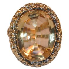 Magnificent English Regency Citrine Ring in Chased Gold. Antique citrine ring set in 15K gold. The chased bezel has a floral motif creating a beautiful frame that enhances the large stone. England, circa 1820