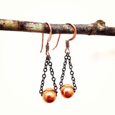 A pair of Copper bead dangles on antiqued brass chain with Copper Earwire.Please wear you piece with care.