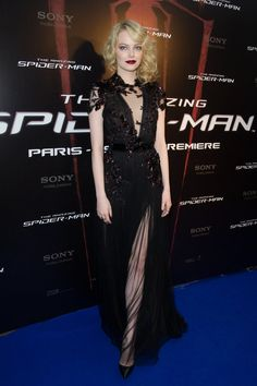 Va-Va-Voom! See the Sexiest Dresses to Hit the Red Carpet in 2012 : Emma Stone stunned in this Fall '12 Gucci number at the Paris premiere of The Amazing Spider-Man, complementing the siren look with 1920s-inspired waves and a deep crimson lip.