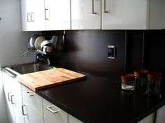 Clever way to cover an ugly counter with wood? Make this large enough for the island and set on top.