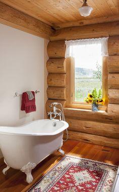Log cabin bathroom with claw-foot tub - Photo by Heidi A. Long - Cabin Life Magazine