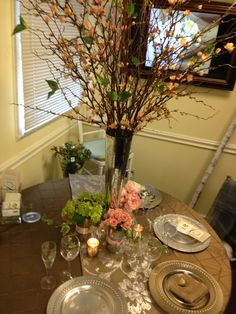 tall centerpieces with pink quince