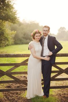 Image by  Juliet Mckee Photography - A Vintage country style budget wedding with a flower crown a pink and coral colour scheme and a beautiful bride in a backless dress