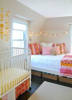 Cute idea for a shared room (love the string lights and mobile over the crib).  Not that I would EVER have my children share rooms cause I'm going to have a big house :)