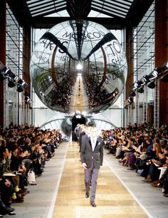 """Paris-meets-Tokyo was the theme of Kim Jones's (under the direction of Marc Jacobs) fall 2012 show for Louis Vuitton, but from an unexpected perspective. The City of Light has long influenced global fashion, but Jones began wondering about Japan's influence on France—""""the cross-fertilization that has occurred from the 19th century onwards,"""" he explained—through the lens of American fashion illustrator Antonio Lopez's 1970s and '80s works. How to get the point across on stage? Besides looks…"""