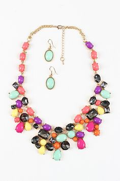 Finish off your colorful style with the Candy Wonder Necklace. This necklace features small curb link chain with multi size and color front with unique style finished with lobster claw closure. Necklace includes matching earrings. Lead and nickel free.